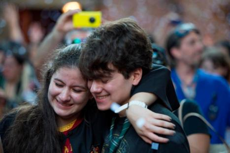 Above: Fans embrace at the opening of the WWoHP - Diagon Alley yesterday