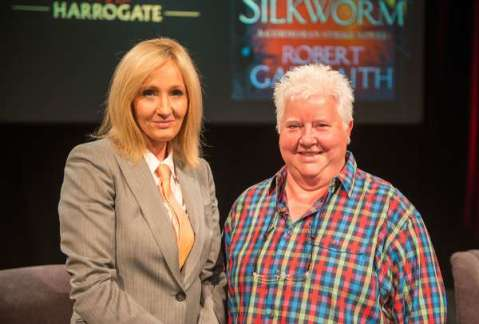She be on her suit and tie: J.K. Rowling, pictured above with Val McDermid, appeared at Theaksten Crime Writing Festival as Robert Galbraith.
